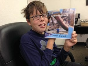 Thomas with Biggest Little Photographer Proof Book 10.4.16
